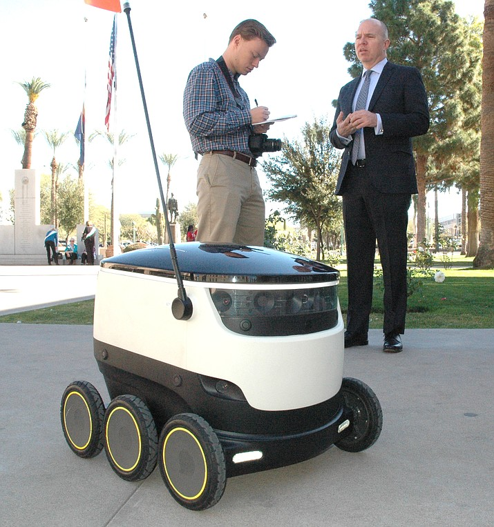 "David Catania, spokesman for Estonia-based Starship Technologies, right, explains earlier this year how automated ""personal delivery devices"" could work in Arizona with a change in state law allowing them to use the sidewalks. (Capitol Media Services file photo by Howard Fischer)"
