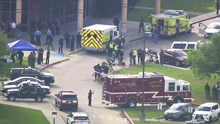 In this image taken from video emergency personnel and law enforcement officers respond to a high school near Houston after an active shooter was reported on campus, Friday, May 18, 2018, in Santa Fe, Texas. The Santa Fe school district issued an alert Friday morning saying Santa Fe High School has been placed on lockdown. (KTRK-TV ABC13 via AP)