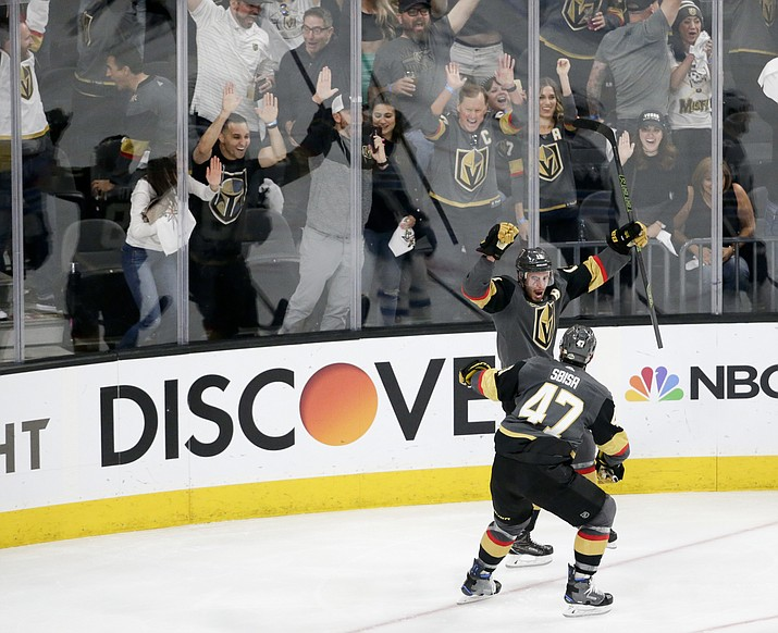 Vegas Golden Knights right wing Reilly Smith, back, celebrates his goal with Luca Sbisa during the third period against the Winnipeg Jets in Game 4 of the NHL hockey Western Conference finals Friday, May 18, 2018, in Las Vegas. (Marc Sanchez/AP)