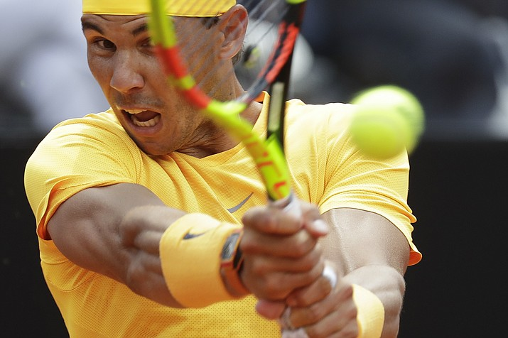 Spain's Rafael Nadal returns the ball to Italy's Fabio Fognini during a quarter final match at the Italian Open tennis tournament in Rome, Friday, May 18, 2018. Nadal won 4-6, 6-1, 6-2. (Andrew Medichini/AP)
