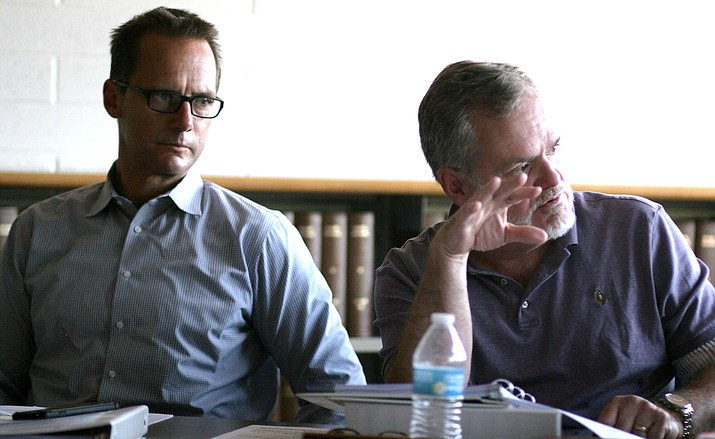 Mingus Union School Board members Steve Gesell, left, and Jim Ledbetter, at Thursday's meeting. After nearly four hours, the board voted to take no action in merging with the Cottonwood-Oak Creek District. (Photo by Bill Helm)