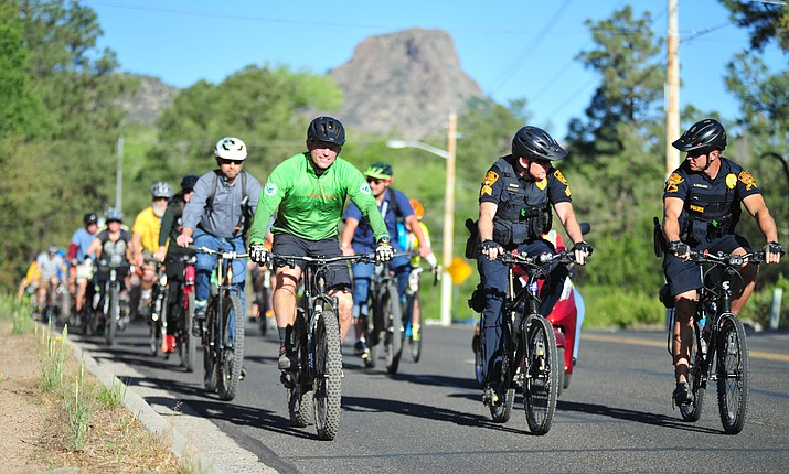 Prescott Mayor Greg Mengarelli leads a group of about 50 bicyclists down Gurley Street in the city's annual Bike to Work with the Mayor ride Friday, May 18, 2018 in Prescott. (Les Stukenberg/Courier)