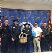 PVPD family violence unit thanks community  members for donated cell phones photo