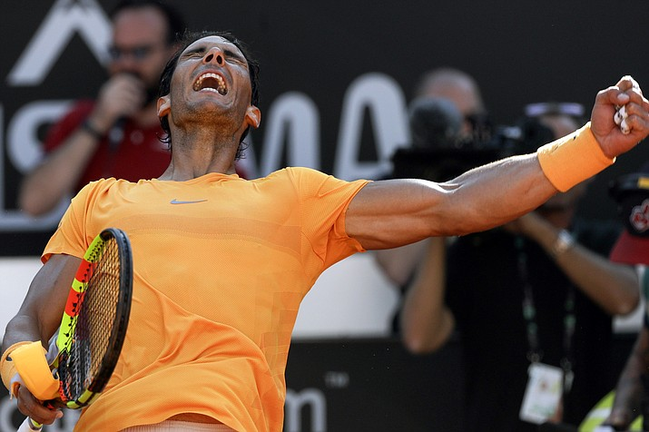Spain's Rafael Nadal celebrates after winning his semifinal match against Serbia's Novak Djokovic at the Italian Open tennis tournament, in Rome, Saturday, May 19, 2018. (Gregorio Borgia/AP)