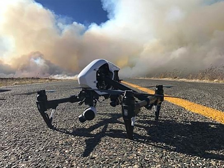 The quadcopter, commonly known as a drone, proved itself in a fire locally last October when one flown by Yavapai College faculty member Matt Mintzmyer used it to show firefighters working a blaze near Ash Fork where to find the flames when clouds of smoke obscured them. (Courtesy)