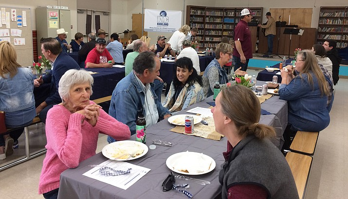 More than 100 people showed up for the Community Outreach barbecue hosted by Kirkland Mining Company President Areta Zouvas, center with dark hair, and her family Feb. 10 in the Skull Valley Elementary School. (Sue Tone/Courier)