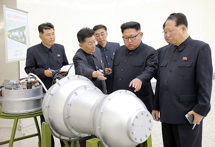 This undated file photo distributed on Sept. 3, 2017, by the North Korean government, shows North Korean leader Kim Jong Un, second from right, at an undisclosed location in North Korea. Foreign journalists will journey into the mountains of North Korea this week to observe the closing of the country's nuclear test site, a display of goodwill ahead of leader Kim Jong Un's planned summit with President Donald Trump. (Korean Central News Agency/Korea News Service via AP, File)