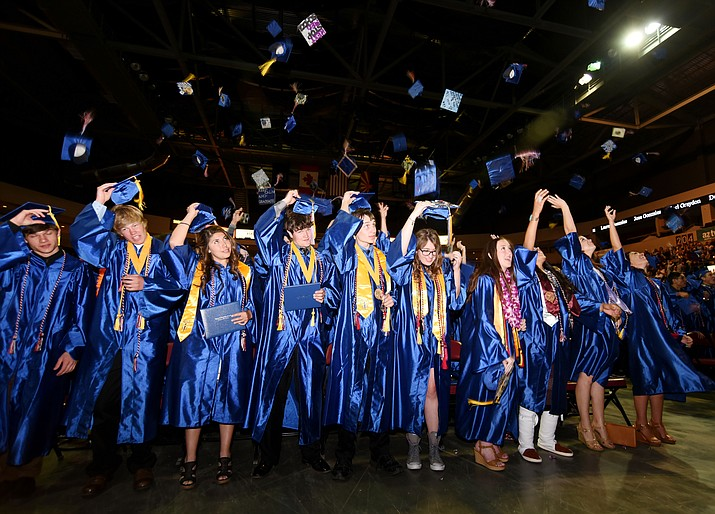 Students toss their mortar boards at the Chino Valley High School Class of 2016 Graduation Ceremony on May 25, 2016, in Prescott Valley. (Les Stukenberg/Review, file)