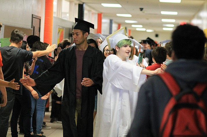 Graduates give high-fives to the Williams kindergarten class during the Grad Walk at Williams Elementary-Middle School May 16. (Wendy Howell/WGCN)