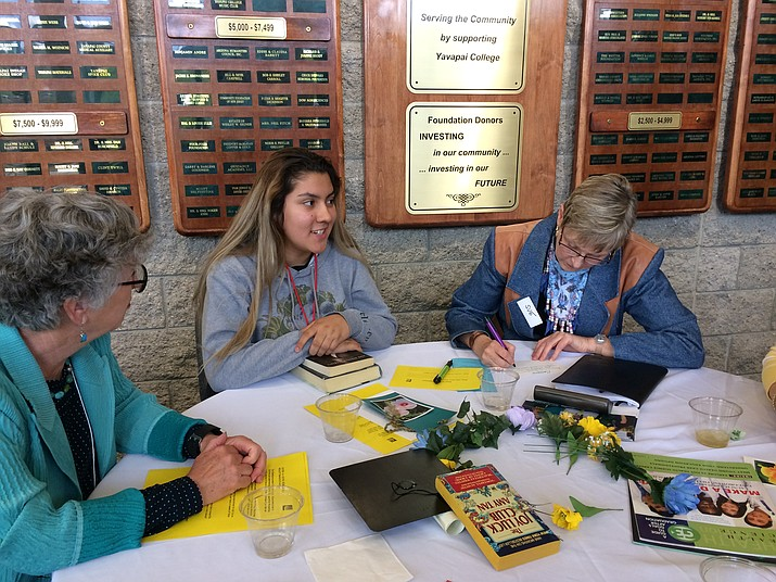 Bianca Escobedo, center, a sophomore at Camp Verde High School, talks about studying graphic arts in college as AAUW member Sue Marceau, right, writes it down. AAUW member Kathy Capelle joins in the conversation at the Sister to Sister Luncheon May 1 at Yavapai College. (Sue Tone/Tribune)