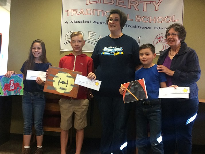 Marlena Craig, left, Jaxson Rice, second from left, and Avery Portugal, second from right, were the only Arizona winners in the Fraternal Order of Eagles' 2018 Children's Art Contest. Also pictured are Liberty Traditional School Assistant Principal Kimberly Yates, center, and Fraternal Order of Eagles Auxiliary member Vickie Scott, right. Scott presented the awards to the students Friday, May 4. (Jason Wheeler/Tribune)