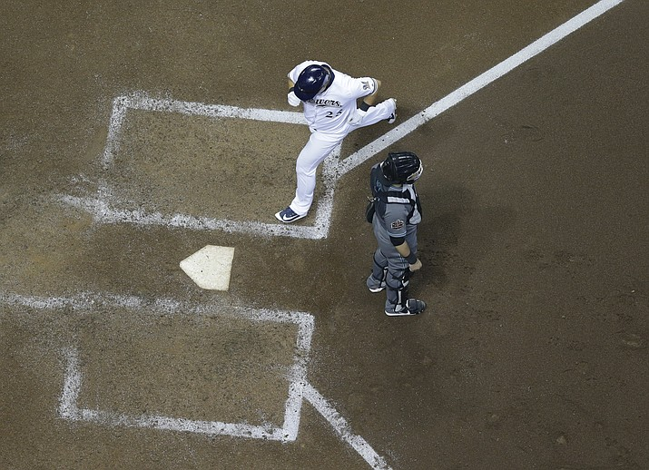 Milwaukee Brewers' Ji-Man Choi scores from third on a sacrifice fly by Domingo Santana during the sixth inning of a baseball game against the Arizona Diamondbacks Tuesday, May 22, 2018, in Milwaukee. (Morry Gash/AP)