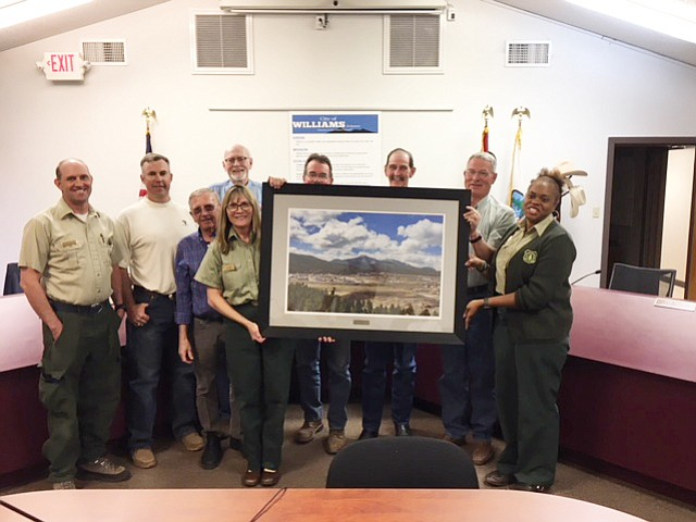 A photo of Bill Williams Mountain is presented to the mayor and city council April 26 by Kaibab National Forest. (Submitted photo)