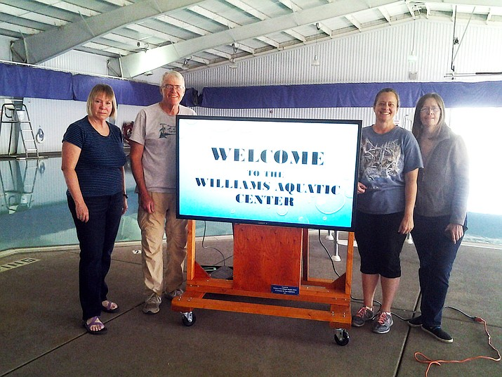 Jeana Stevenson, Tom Hooker, Michelle Walker and Cathy Bates display a TV purchased by the Friends of the Williams Aquatic Center. (Submitted photo)