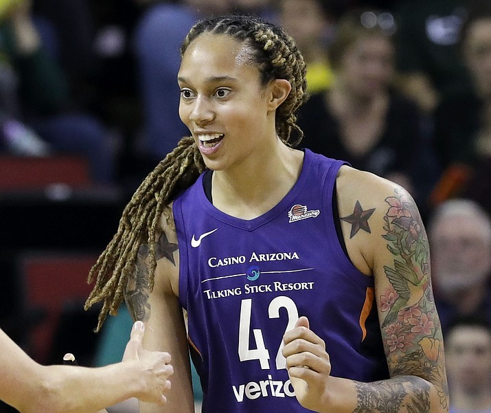Phoenix Mercury's Brittney Griner reacts after a play against the Seattle Storm in a WNBA basketball game Sunday, May 20, 2018, in Seattle. (Elaine Thompson/AP, File)
