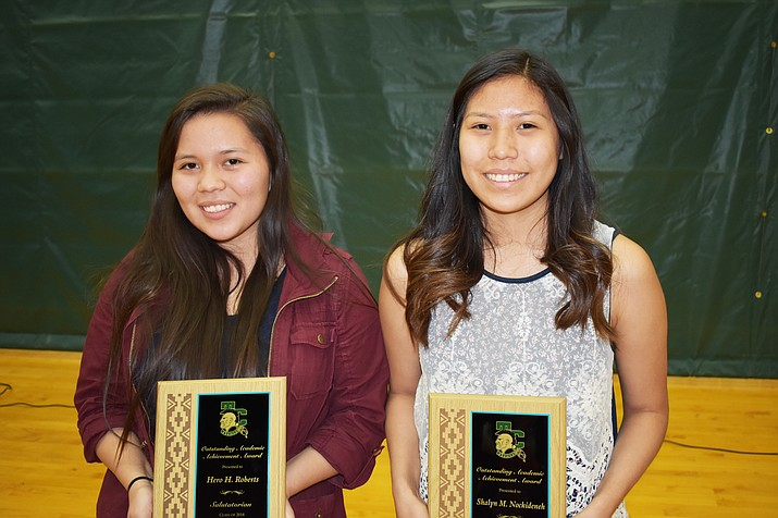 Tuba City HIgh School 2018 salutatorian Hero H. Roberts  (left) and valedictorian Shalyn Nockideneh. Both young women had the highest GPA for the graduating class at Tuba City High and both are interested in pursuing a degree in medicine after graduation. (Rosanda Suetopka Thayer/NHO)