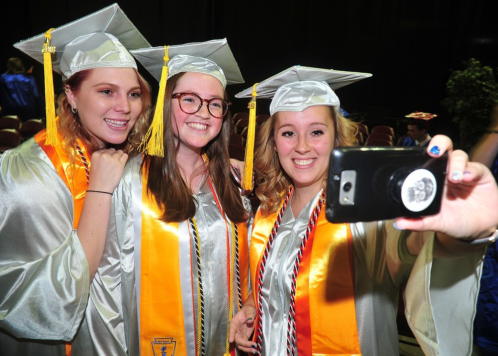 Lauren Joseph, Alexis Mastin and Sophia Davis-Babb take a selfie before the Chino Valley Commencement held Wednesday, May 23, 2018 at the Prescott Valley Event Center. (Les Stukenberg/Courier)