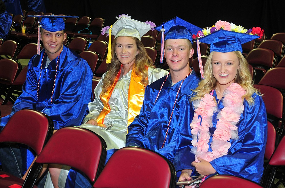 Tyler Hixson, Keigan Willingham, Zach Paris and Madilyn Lawrence before the Chino Valley Commencement held Wednesday, May 23, 2018 at the Prescott Valley Event Center. (Les Stukenberg/Courier)