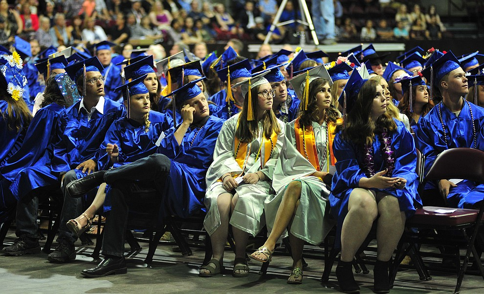 Watching the senior memories video on the big screens at the Chino Valley Commencement held Wednesday, May 23, 2018 at the Prescott Valley Event Center. (Les Stukenberg/Courier)