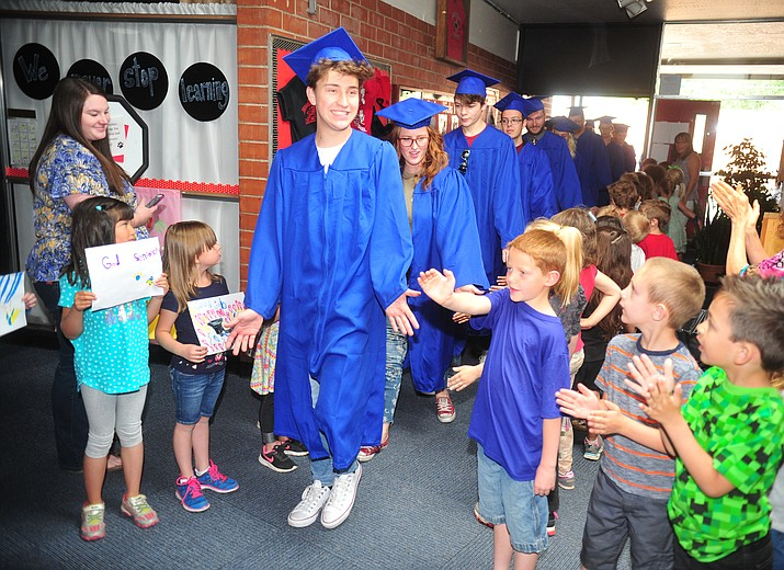Prescott High School soon-to-be graduates get high and low fives from Taylor Hicks students as they took their Wednesday, May 23, 2018 morning off as they went on their Senior Celebration Tour visiting the elementary and middle schools they may have attended in the past. (Les Stukenberg/Courier)