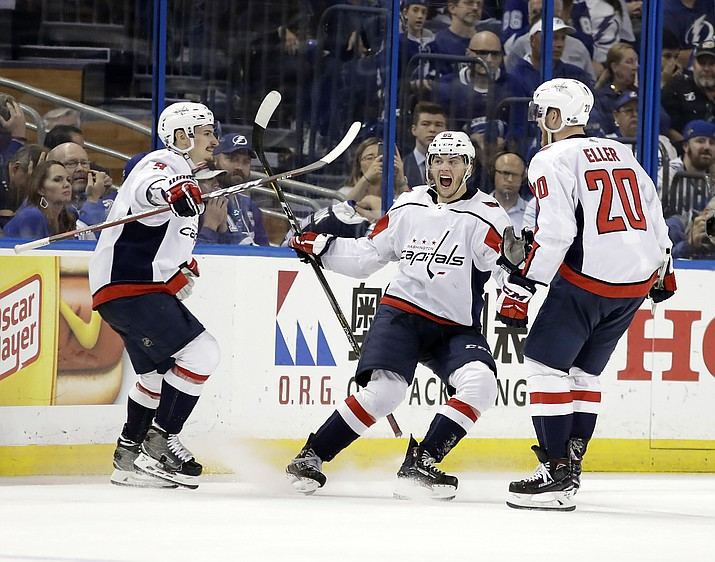 Washington Capitals left wing Andre Burakovsky, center, celebrates his goal against the Tampa Bay Lightning with teammates Dmitry Orlov, left, and Lars Eller (20) during the second period of Game 7 of the NHL hockey playoffs Eastern Conference finals Wednesday, May 23, 2018, in Tampa, Fla. (Chris O'Meara/AP)