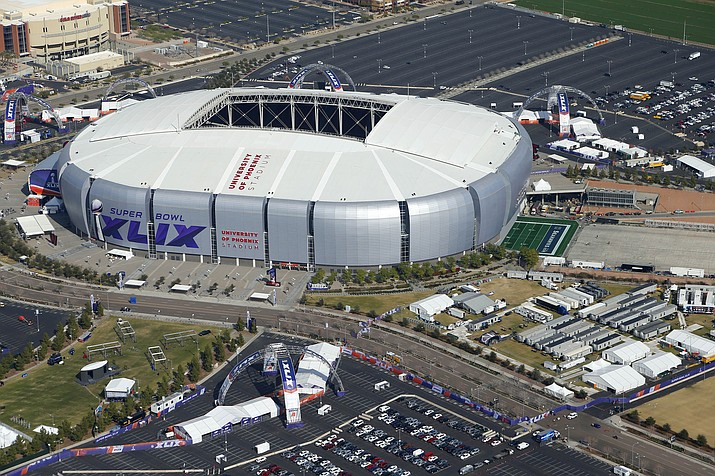 This is a Jan. 28, 2015, aerial file photo showing University of Phoenix Stadium in Glendale, Ariz., site of Super Bowl XLIX. The NFL has awarded future Super Bowls to Arizona and New Orleans. The decision was made Wednesday, May 23, 2018, at the league's annual spring meeting in Atlanta, which will host the 2019 Super Bowl at Mercedes-Benz Stadium. (Ross D. Franklin/AP, File)