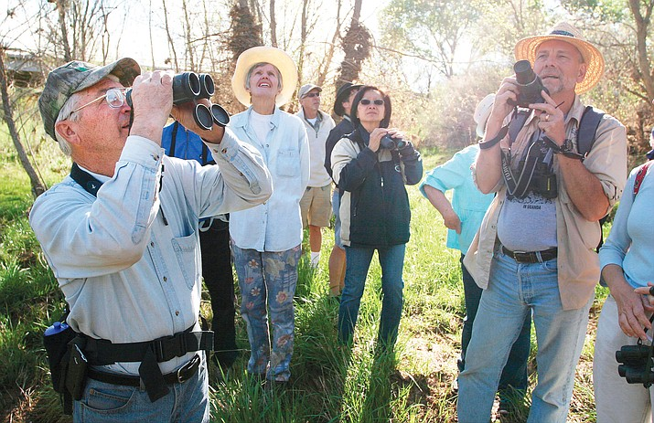 "Volunteering with more than a dozen worthy causes is why Camp Verde resident Chip Norton is ""flunking retirement."" Norton, pictured at left, leads a birding expedition along the Verde River's Black Bridge access point. (Photo by Bill Helm)"