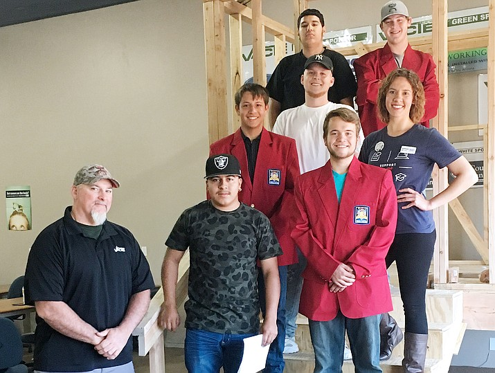 SupportMyClub.org Program Manager Christina Hawbaker joins with construction students from Valley Academy of Career and Technology Education as they wear donated SkillsUSA jackets. Also pictured, VACTE construction teacher Travis Black. (Courtesy photo)
