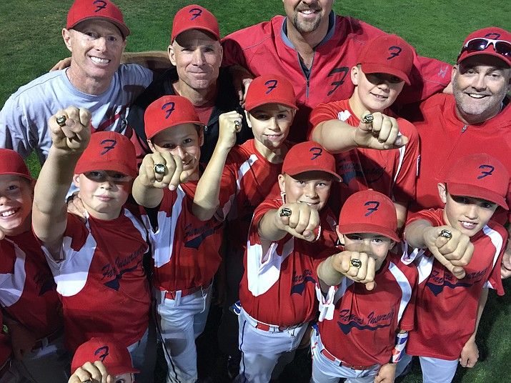 Prescott Little League's Farmers Insurance club shows off their championship rings after defeating Kiwanis 3-2 in extra innings Thursday, May 24, 2018, in Prescott. Farmers Insurance claimed the Prescott City Championship Tournament title and finished a perfect 15-0 on the season. (Brian M. Bergner Jr./Courier)