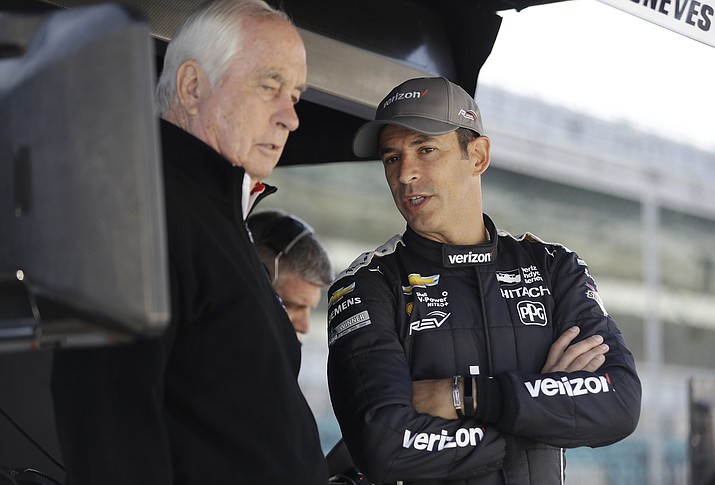 Helio Castroneves, right, of Brazil, talks with Roger Penske before a practice session for the IndyCar Grand Prix auto race at Indianapolis Motor Speedway, in Indianapolis Friday, May 11, 2018. (Darron Cummings/AP, File)