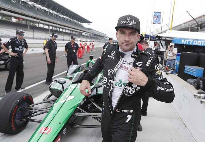 Jay Howard pulls off his racing suit after he qualified for the IndyCar Indianapolis 500 auto race at Indianapolis Motor Speedway in Indianapolis, Saturday, May 19, 2018. (Michael Conroy/AP)