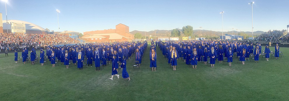 The 349 members of Prescott High School's Class of 2018 gather at the beginning of their commencement ceremony Friday, May 25, 2018, as the color guard comes forward, on Bill Shepherd Field at Prescott High School. (Les Stukenberg/Courier)