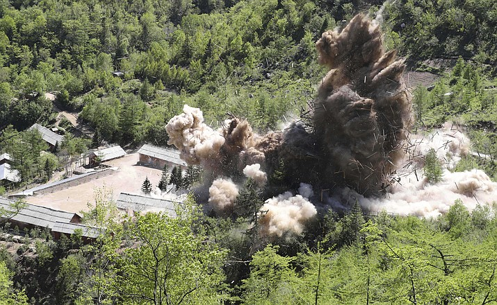 In this Thursday, May 24, 2018 photo, command post facilities of North Korea's nuclear test site are blown up in Punggye-ri, North Korea. (Korea Pool/Yonhap)