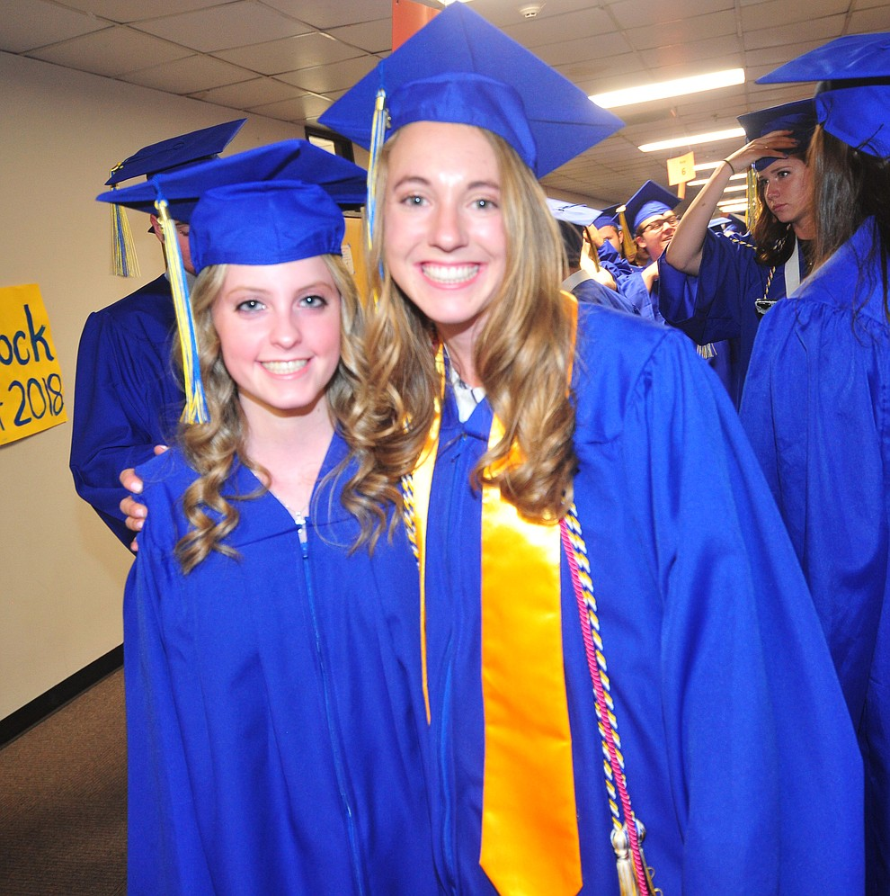 Gabriella Baumgartner and McKenzie Roberts before the 2018 Prescott High School Commencement Ceremony at the school Friday, May 25, 2018. (Les Stukenberg/Courier)