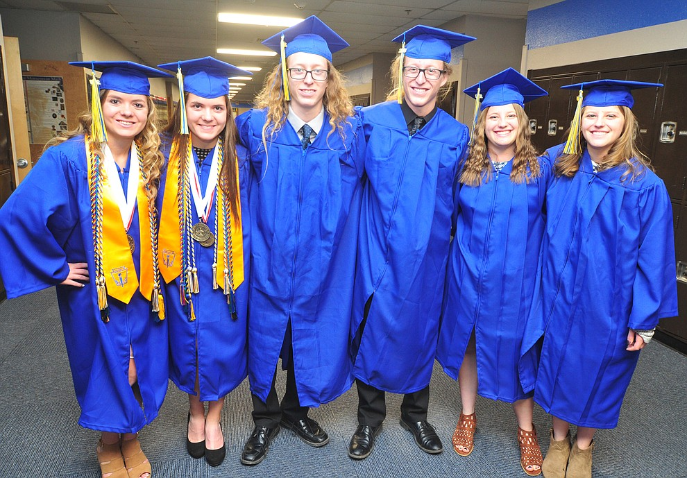 Three sets of identical twins pose before the 2018 Prescott High School Commencement Ceremony at the school Friday, May 25, 2018. From left; Kirsten and Kara Hillig, Jason and Jonah Howard along with Alex and Drew Shumaker (Les Stukenberg/Courier)