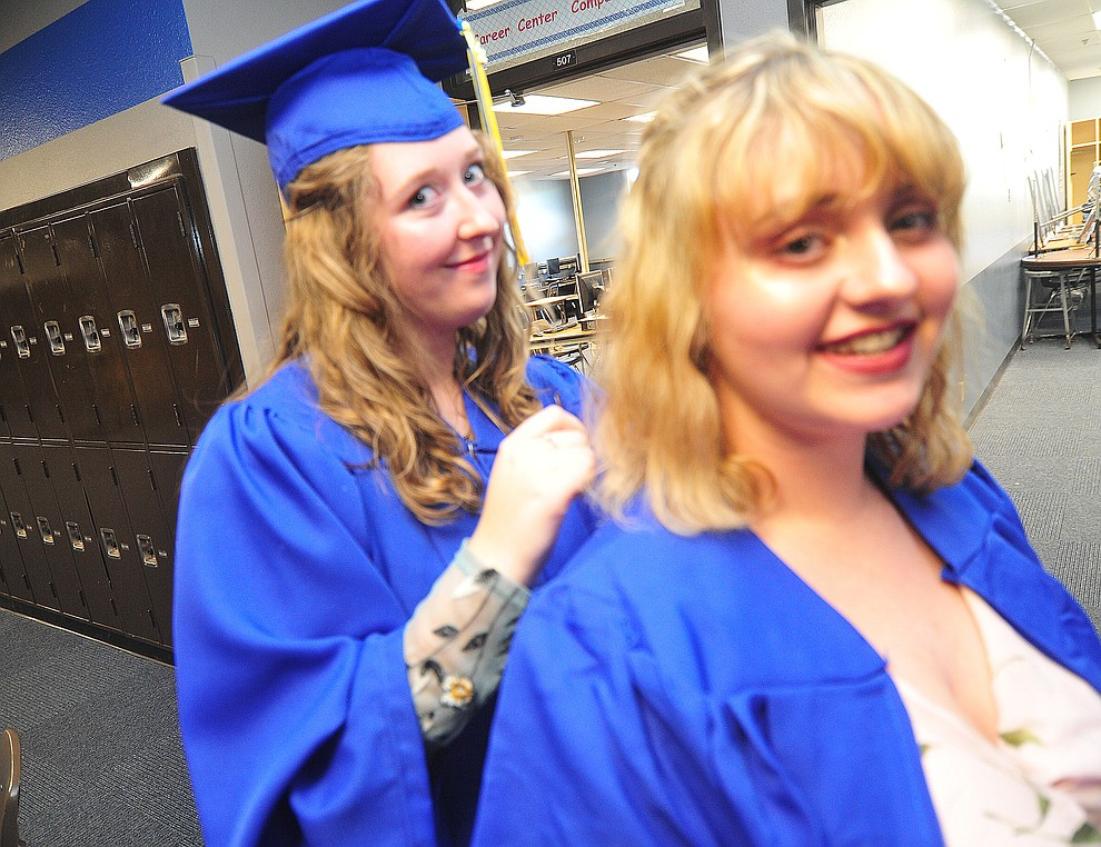 Giselle Lewis helps Abbey Stockmar with her hair before the 2018 Prescott High School Commencement Ceremony at the school Friday, May 25, 2018. (Les Stukenberg/Courier)