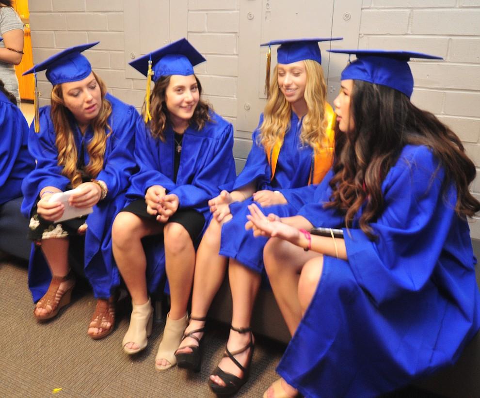Abby Nelson, Hannah Nelson, Scarlett Manrique and Renee Kasten talk before the 2018 Prescott High School Commencement Ceremony at the school Friday, May 25, 2018. (Les Stukenberg/Courier)