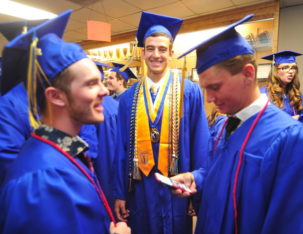 Jacob Henwood, Charles Hicks and Sam Ward share a laugh before the 2018 Prescott High School Commencement Ceremony at the school Friday, May 25, 2018. (Les Stukenberg/Courier)