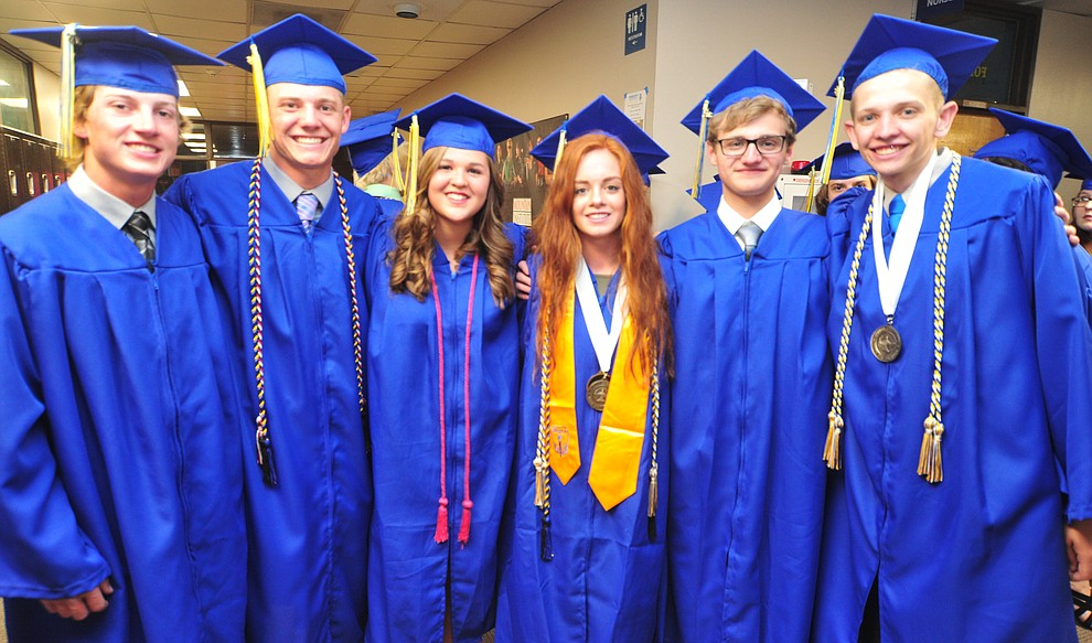 Ryan Holloway, Chase Kasun, Maggie Boelts, Audrey Lockling, Logan Hoots and Isaak Garasha pose for a photo before the 2018 Prescott High School Commencement Ceremony at the school Friday, May 25, 2018. (Les Stukenberg/Courier)