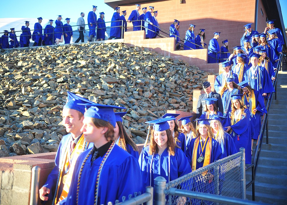 Students walk towards the field and their graduation during the 2018 Prescott High School Commencement Ceremony at the school Friday, May 25, 2018. (Les Stukenberg/Courier)