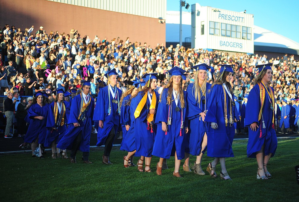 Students walk in the processional during the 2018 Prescott High School Commencement Ceremony at the school Friday, May 25, 2018. (Les Stukenberg/Courier)
