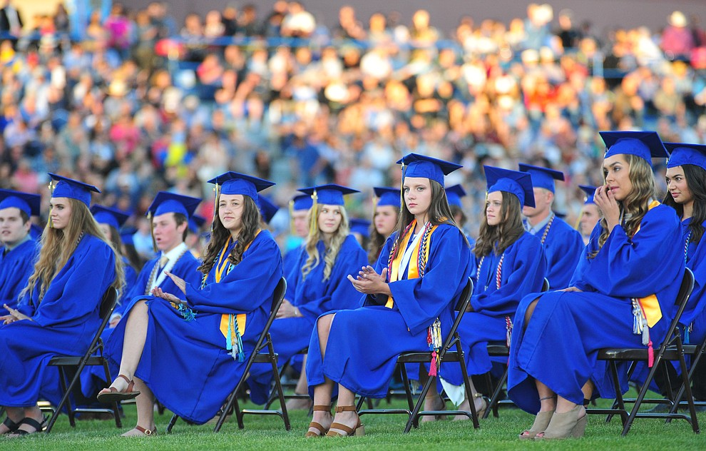 Students listen to a speaker during the 2018 Prescott High School Commencement Ceremony at the school Friday, May 25, 2018. (Les Stukenberg/Courier)