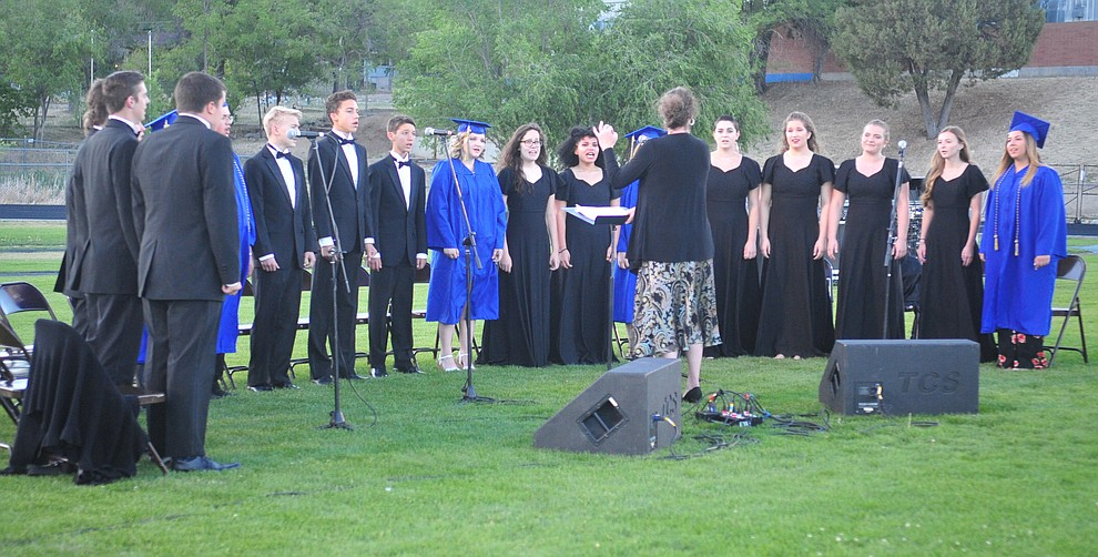 """The Chorale Union sings """"Go the Distance"""" during the 2018 Prescott High School Commencement Ceremony at the school Friday, May 25, 2018. (Les Stukenberg/Courier)"""