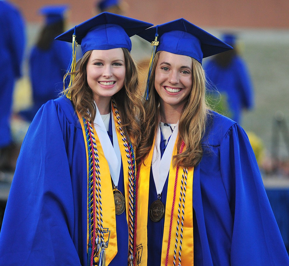 Lexi Hammes and McKenzie Roberts pose during the 2018 Prescott High School Commencement Ceremony at the school Friday, May 25, 2018. (Les Stukenberg/Courier)