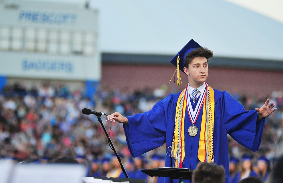 Senior Wesley Bradstreet conducts the concert band during the 2018 Prescott High School Commencement Ceremony at the school Friday, May 25, 2018. (Les Stukenberg/Courier)