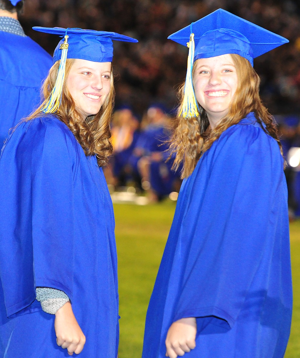 Alex and Drew Shumaker wait to get their diploma during the 2018 Prescott High School Commencement Ceremony at the school Friday, May 25, 2018. (Les Stukenberg/Courier)