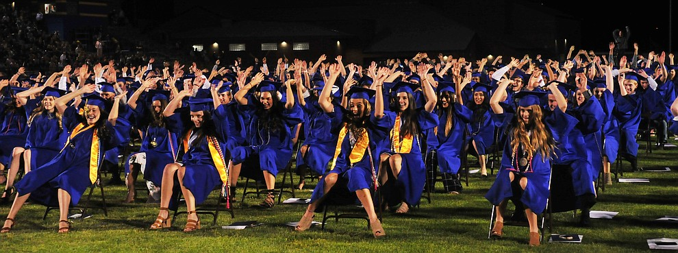 The seniors do their final rollercoaster before graduating during the 2018 Prescott High School Commencement Ceremony at the school Friday, May 25, 2018. (Les Stukenberg/Courier)