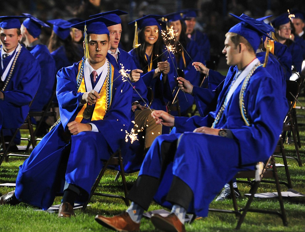 Graduates light sparklers during the 2018 Prescott High School Commencement Ceremony at the school Friday, May 25, 2018. (Les Stukenberg/Courier)