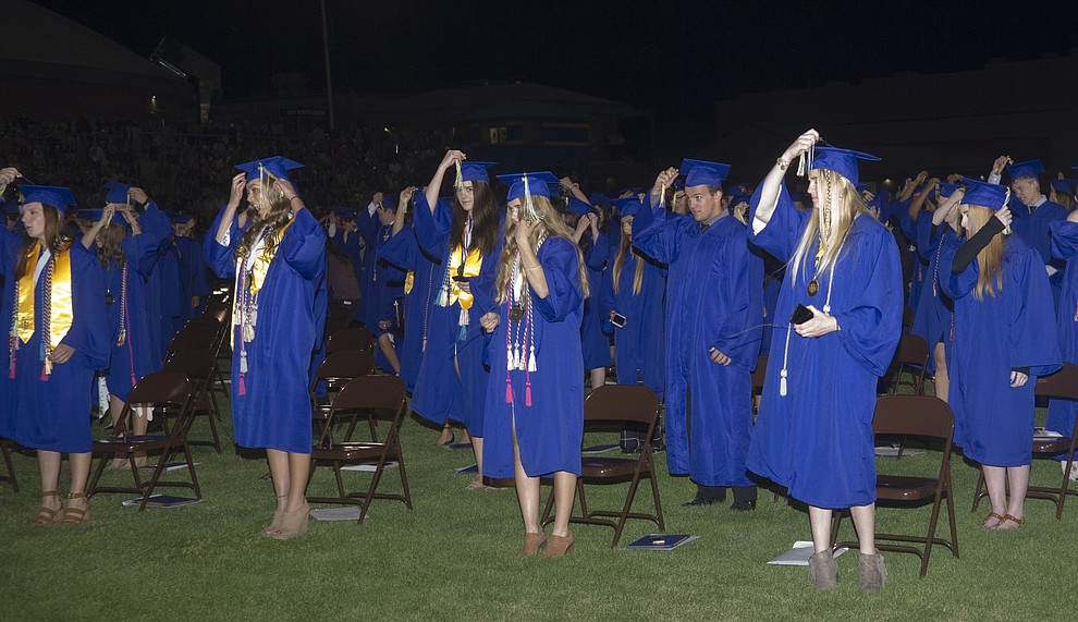 Graduates move thier tassles during the 2018 Prescott High School Commencement Ceremony at the school Friday, May 25, 2018. (Les Stukenberg/Courier)