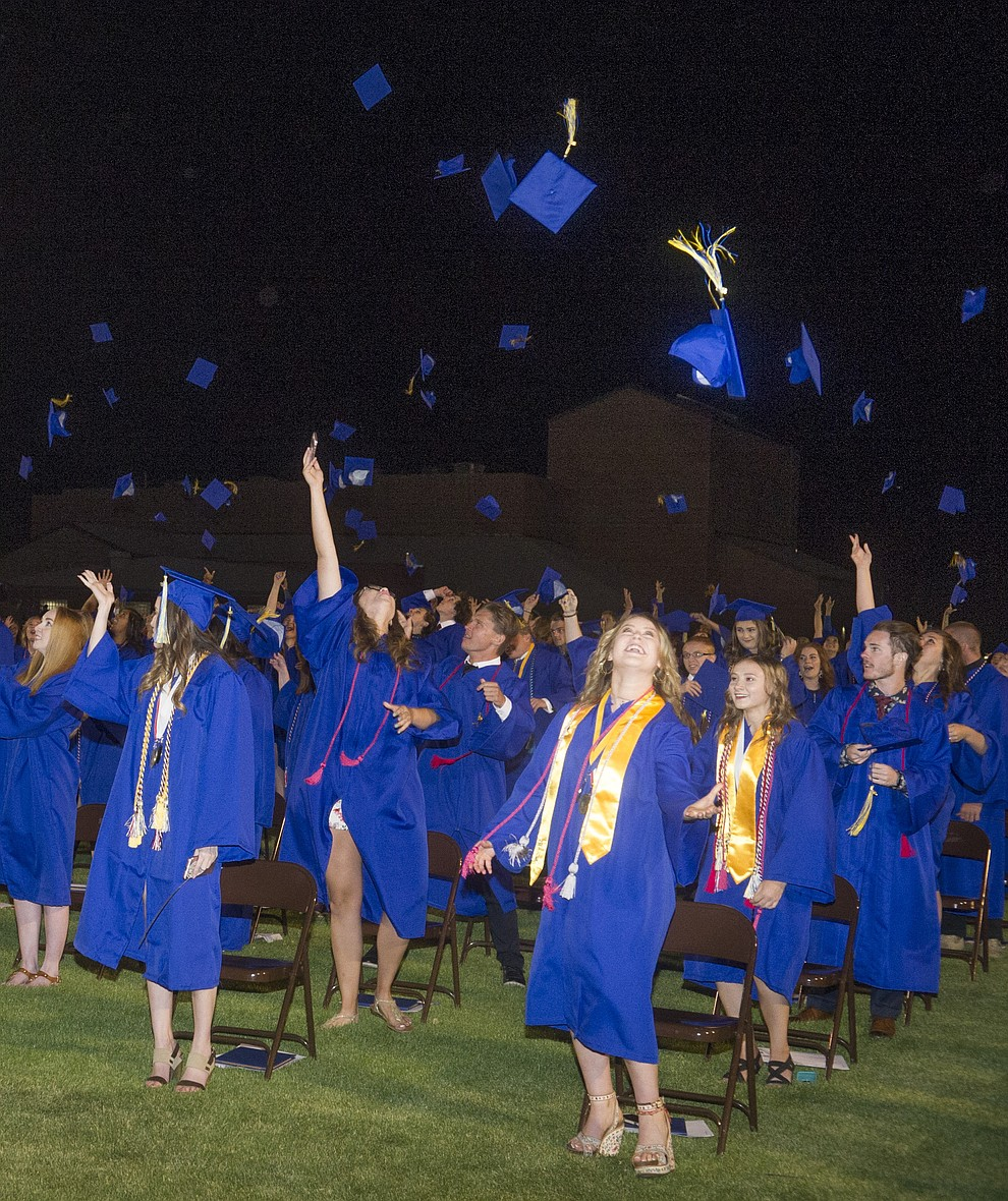 Graduates toss their mortar boars skyward during the 2018 Prescott High School Commencement Ceremony at the school Friday, May 25, 2018. (Les Stukenberg/Courier)